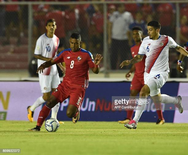 Panama's Edgar Barcenas and Costa Rica's Jose Salvatierra vie for the ball during their 2018 World Cup qualifier football match in Panama City on...