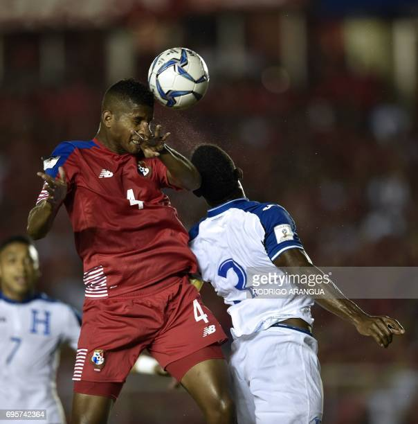 Panama's Fidel Escobar and Honduras' defender Maynor Figueroa jump for the ball during a FIFA World Cup Russia 2018 Concacaf qualifier match in...