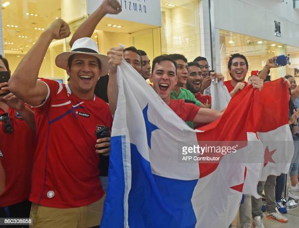 Panama's football team fans wave a national flag and cheer for their team in a mall in Panama City a day after their national team qualified for the...