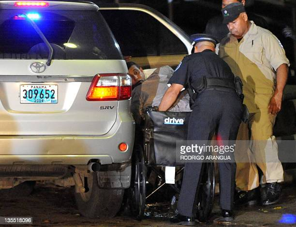 Panama's former dictator Manuel Noriega is carried on a wheelchair upon arrival at Renacer prison 25 km south east of Panama City on December 11 2011...