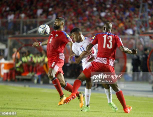 Panama's Gabriel Gomez and Adolfo Machado vie for the ball with Costa Rica's Johan Venegas during their 2018 World Cup qualifier football match in...