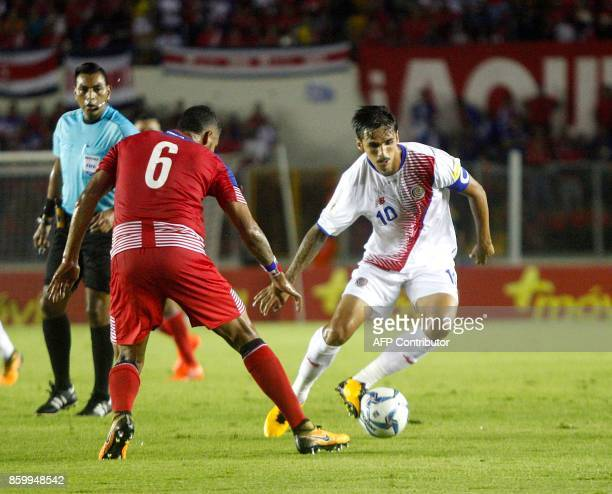 Panama's Gabriel Gomez and Costa Rica's Bryan Ruiz vie for the ball during their 2018 World Cup qualifier football match in Panama City on October 10...