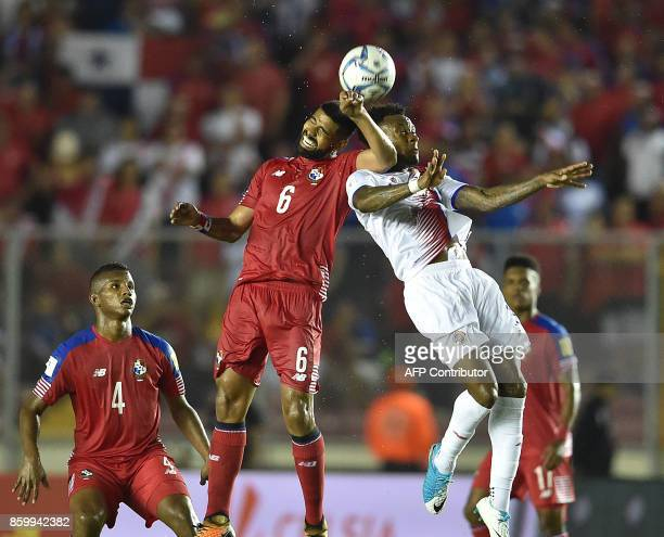 Panama's Gabriel Gomez and Costa Rica's Rodney Wallace vie for the ball during their 2018 World Cup qualifier football match in Panama City on...