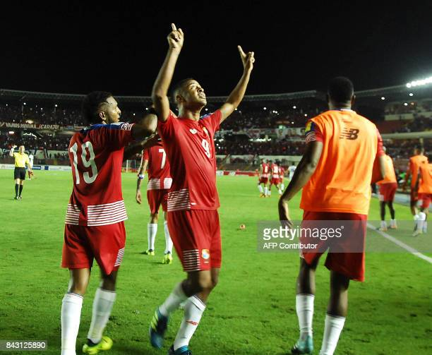 Panama's Gabriel Torres celebrates next to teammate Alberto Quintero after scoring against Trinidad and Tobago during their 2018 World Cup football...