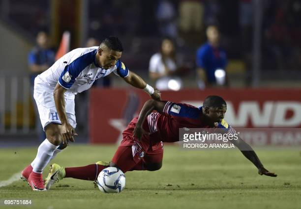 Panama's midfielder Armando Cooper vies for the ball with Honduras' defender Emilio Izaguirre during a FIFA World Cup Russia 2018 Concacaf qualifier...