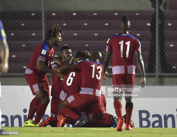 Panama's midfielder Gabriel Gomez celebrates with teammates after scoring against the USA during the 2018 FIFA World Cup qualifier football match in...