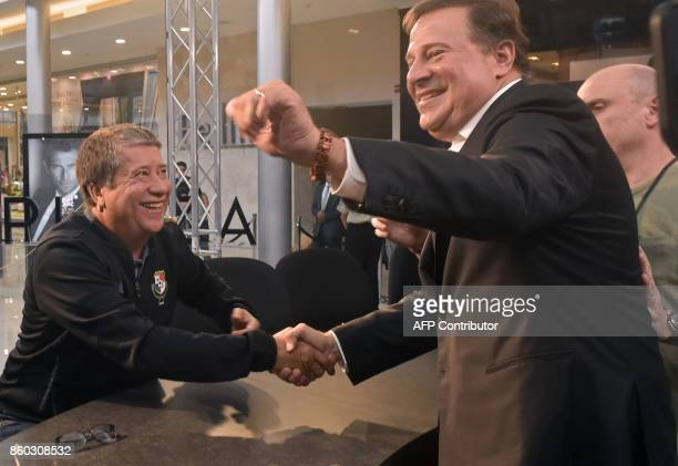 Panama's national football coach Hernan Dario Gomez shakes hands with Panamanian President Juan Carlos Varela during an interview in a mall in Panama...