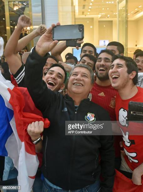 Panama's national football coach Hernan Dario Gomez takes a selfie picture with supporters in a mall in Panama City a day after their national team...
