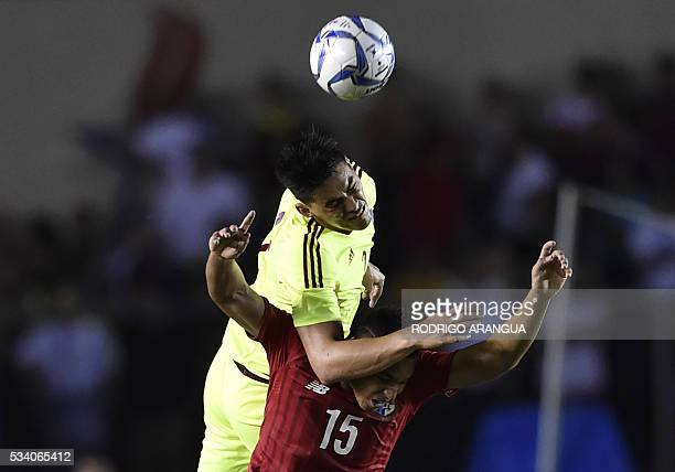 Panama's player Ismael Diaz vies for the ball with Wilker Angel of Venezuela during their friendly football match at the Rommel Fernandez Stadium in...