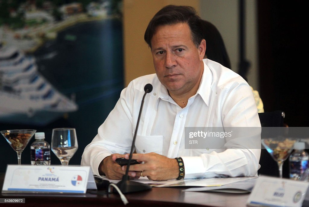 Panama's President Juan Carlos Varela attends the XLVII Ordinary Meeting of the chiefs of state members of the Central American Integration System (SICA) in Roatan island, Honduras, on June 30, 2016. Belize, Costa Rica, El Salvador, Guatemala, Honduras, Nicaragua, Panama and Dominican Republic are members of the SICA. / AFP / STR
