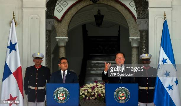 Panama's President Juan Carlos Varela delivers a speech next to his counterpart of Honduras Juan Orlando Hernandez in the presidential Palace in...
