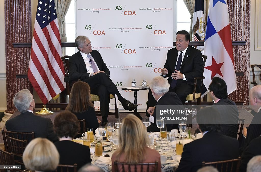 Panama's President Juan Carlos Varela (R) speaks during a discussion with Americas Society/Council of the Americas Chairman Andres Gluski at a luncheon during the Washington Conference on the Americas at the State Department on May 3, 2016 in Washington, DC. / AFP / MANDEL