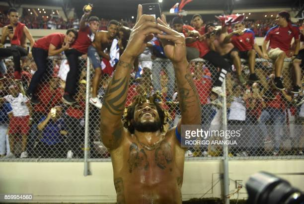 TOPSHOT Panama's Roman Torres takes a picture of his team's fans celebrating after he scored against Costa Rica during their 2018 World Cup qualifier...