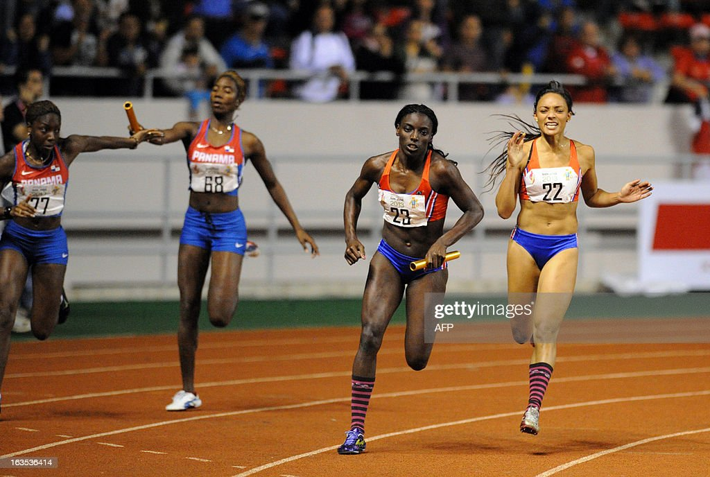 Panama's Ruth Hunt and Gabriela Guevara run to a gold medal next to silver medalists Costa Rica's Shantely Scott and Sarita Morales during the women's 4 x 100 metres relay during the 10th Central American Games in San Jose on March 11, 2013. The 10th Central American Games are taking place from March 3 to 17 in Costa Rica. AFP PHOTO / Ezequiel BECERRA