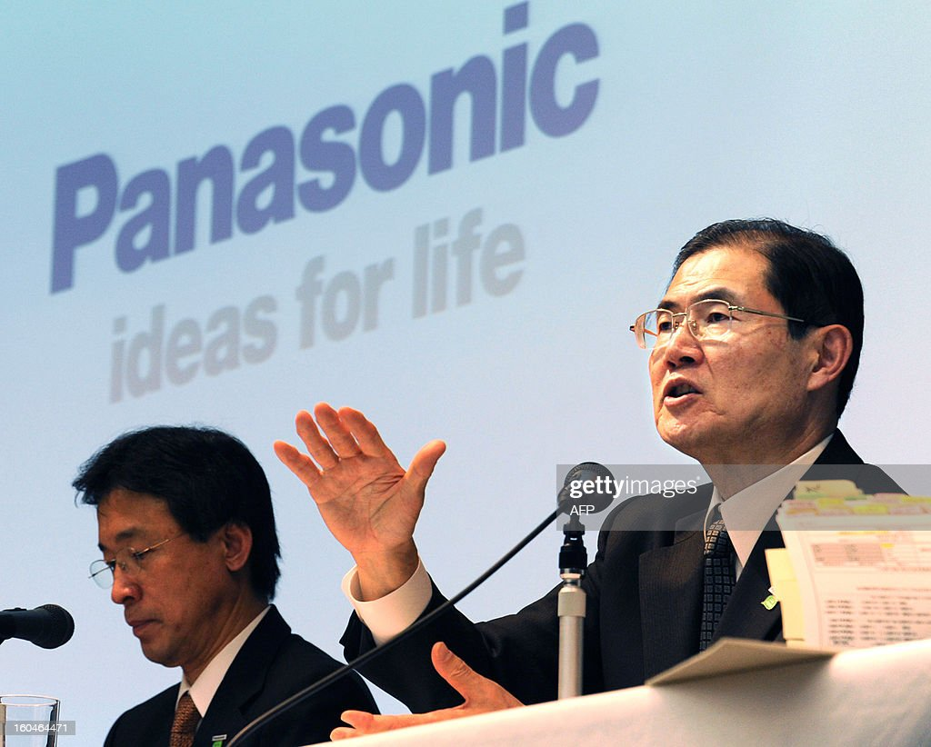 Panasonic Chief Financial Officer Hideaki Kawai (R) answers questions during a press conference to announce the company's financial results in Tokyo on February 1, 2013. Panasonic and Sharp racked up more than 11 billion USD in combined losses over the nine months to December as the embattled Japanese electronics giants warned February 1 there was more bleeding to come.
