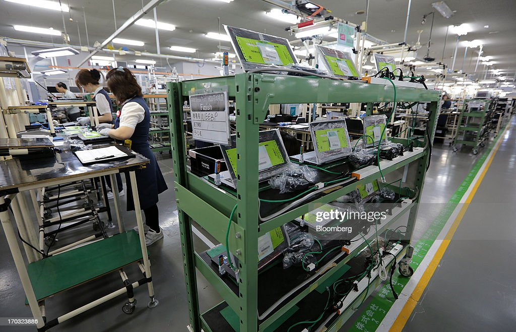 Panasonic Corp. laptop computers are placed on a shelf after inspection on the production line at the company's plant in Kobe City, Hyogo Prefecture, Japan, on Tuesday, June 11, 2013. Panasonic manufactures electric and electronic products. Photographer: Yuriko Nakao/Bloomberg via Getty Images
