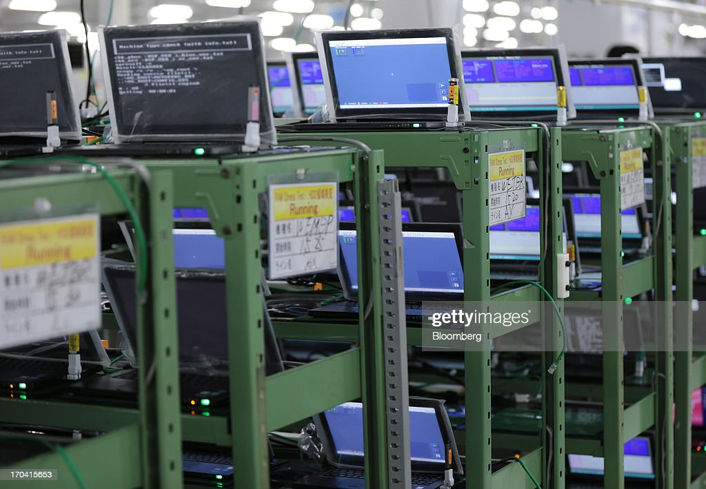 Panasonic Corp.'s Let's Note laptop computers undergo a running test on the production line at the company's plant in Kobe City, Hyogo Prefecture, Japan, on Tuesday, June 11, 2013. Panasonic manufactures electric and electronic products. Photographer: Yuriko Nakao/Bloomberg via Getty Images