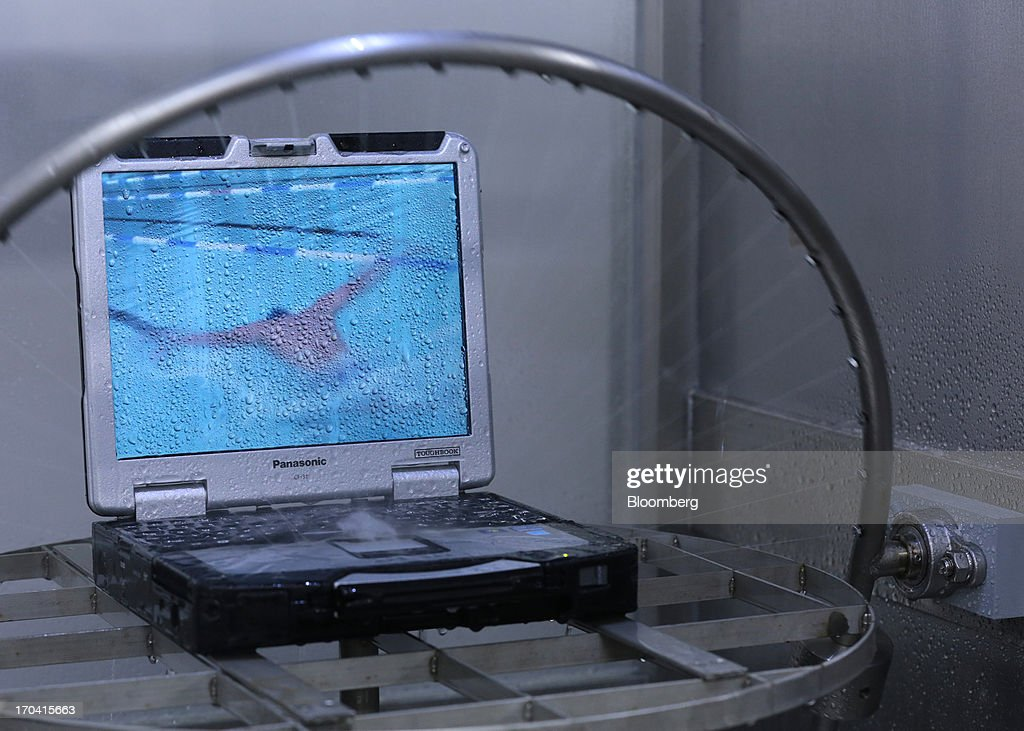 Panasonic Corp.'s Toughbook laptop computer undergoes a water resistance test at the company's plant in Kobe City, Hyogo Prefecture, Japan, on Tuesday, June 11, 2013. Panasonic manufactures electric and electronic products. Photographer: Yuriko Nakao/Bloomberg via Getty Images