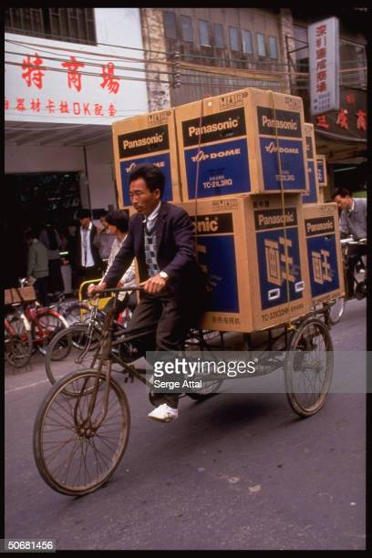 Panasonic electronics being delivered on bicycle cart in city