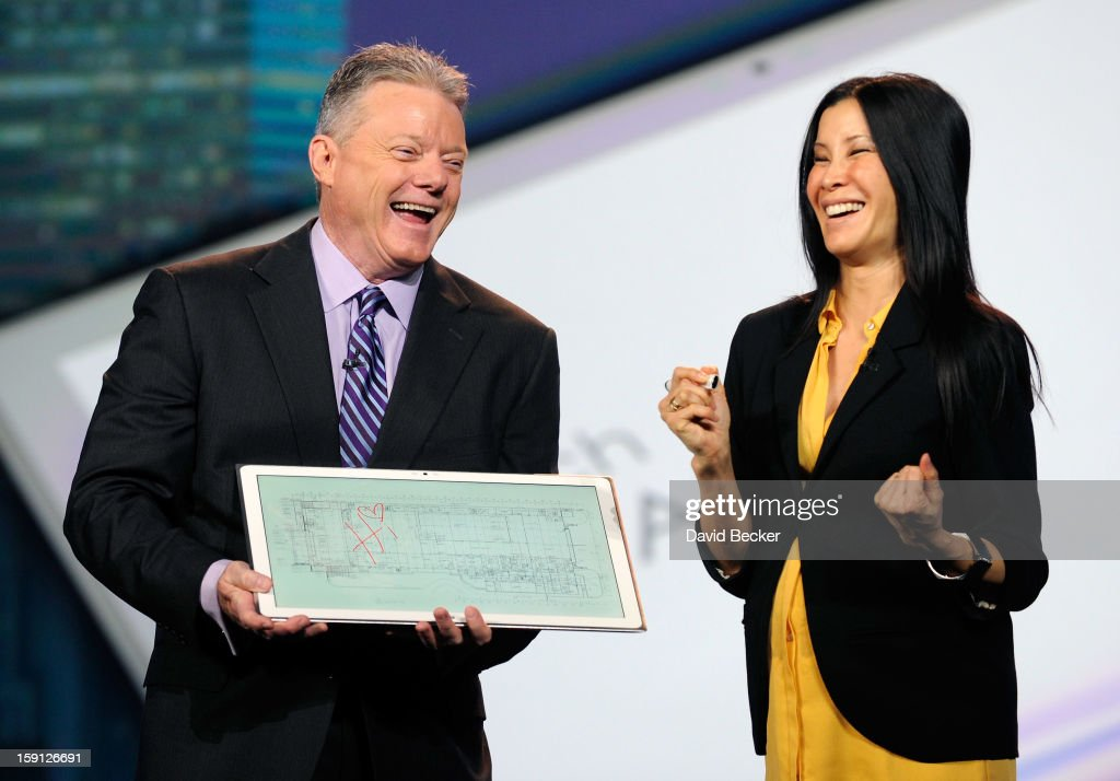 Panasonic North America CEO Joe Taylor (L) displays Panasonic's new 4K 20 inch tablet with host Lisa Ling during a keynote address at the 2013 International CES at The Venetian on January 8, 2013 in Las Vegas, Nevada. CES, the world's largest annual consumer technology trade show, runs through January 11 and is expected to feature 3,100 exhibitors showing off their latest products and services to about 150,000 attendees.