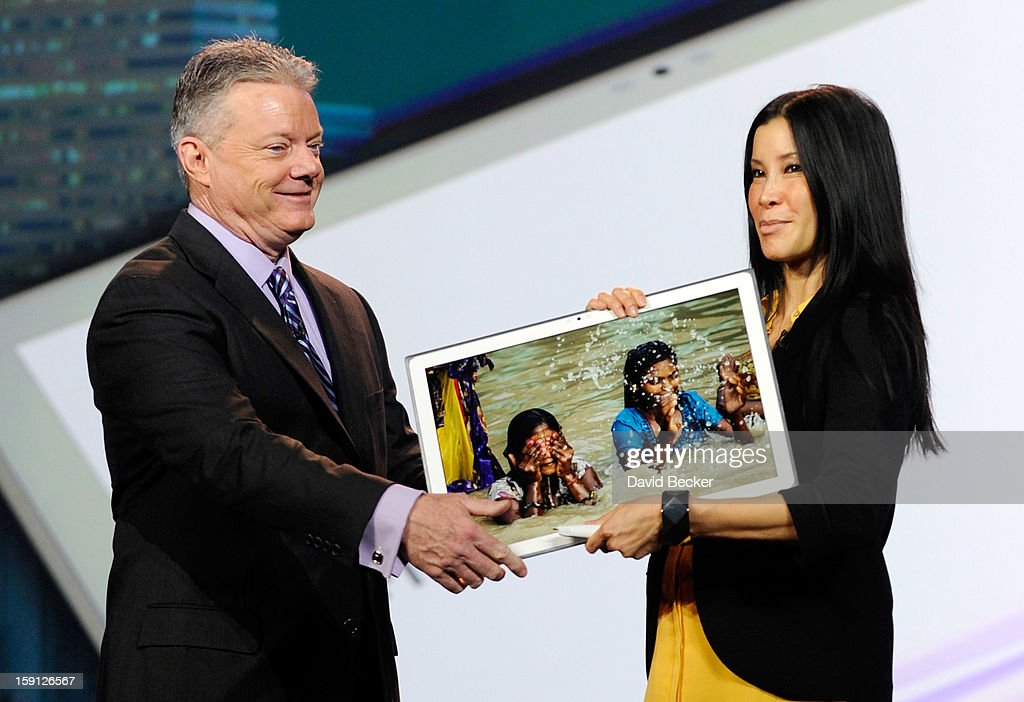 Panasonic North America CEO Joe Taylor (L) hands off Panasonic's new 4K 20 inch tablet to host Lisa Ling during a keynote address at the 2013 International CES at The Venetian on January 8, 2013 in Las Vegas, Nevada. CES, the world's largest annual consumer technology trade show, runs through January 11 and is expected to feature 3,100 exhibitors showing off their latest products and services to about 150,000 attendees.