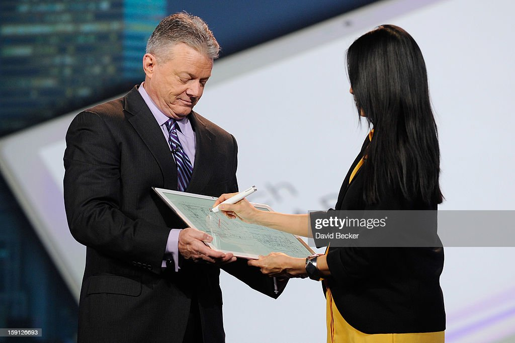 Panasonic North America CEO Joe Taylor (L) holds Panasonic's new 4K 20 inch tablet as host Lisa Ling uses a stylus on it during a keynote address at the 2013 International CES at The Venetian on January 8, 2013 in Las Vegas, Nevada. CES, the world's largest annual consumer technology trade show, runs through January 11 and is expected to feature 3,100 exhibitors showing off their latest products and services to about 150,000 attendees.