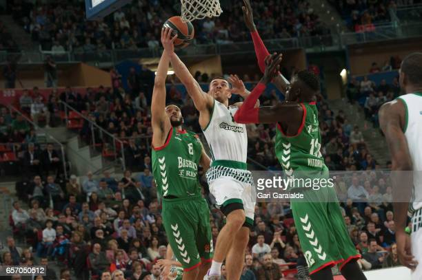 Panathinaiko's American guard Mike James #5 vies with Baskonia's Hungarian forward Adam Hanga #8 and Spanish center Ilimane Diop #12 during the...