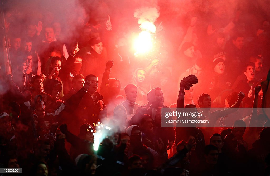 Panathinaikos fans light up signal flares during the Superleague match between Panathinaikos FC and Olympiacos Piraeus at OAKA Stadium on December 9, 2012 in Athens, Greece.