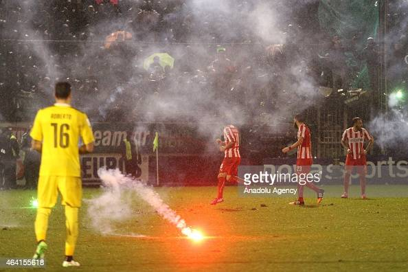 Panathinaikos fans throw flares onto the pitch at the end of the Greek Super League match between Panathinaikos FC v Olympiacos at the Apostolos...