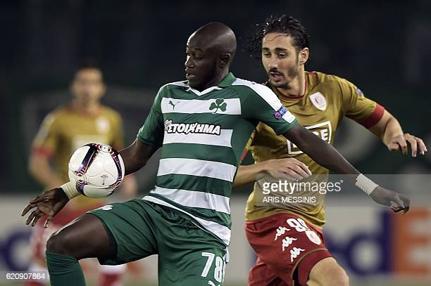Panathinaikos' French defender Ousmane Coulibaly fights for the ball with Standard Liege's Algerian forward Ishak Belfodil during the UEFA Europa...