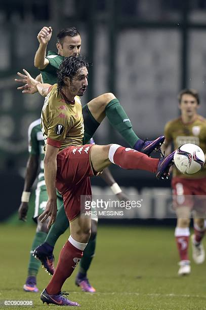 Panathinaikos' Giandomenico Mesto fights for the ball with Standard Liege's Algerian forward Ishak Belfodil during the UEFA Europa League Group G...