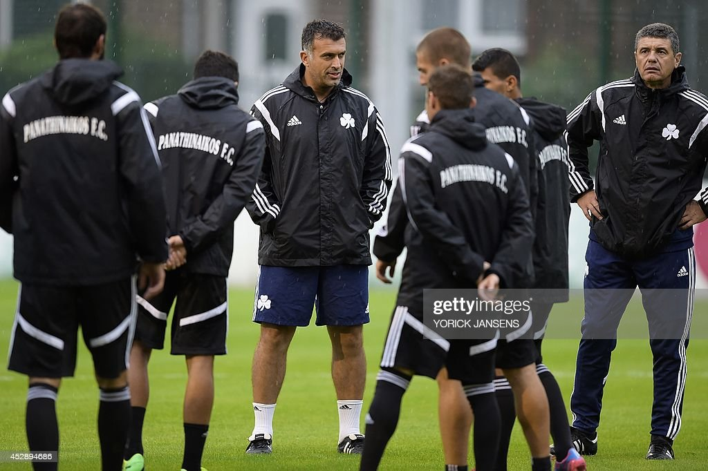 Panathinaikos' head coach Giannis Anastasiou (C) briefs players during a training session of his football team on July 29, 2014, in Liege a day ahead of their first leg match in the third qualifying round of the UEFA Champions League competition against Belgian first league team Standard de Liege. AFP PHOTO / BELGA / PHOTO YORICK JANSENS Belgium Out