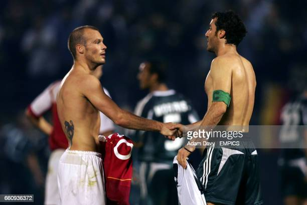 Panathinaikos' Ioannis Goumas and Arsenal's Fredrik Ljungberg shake hands at the final whistle