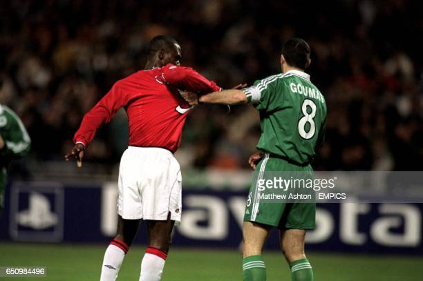 Panathinaikos' Ioannis Goumas gets a good grip of Manchester United's Andy Cole