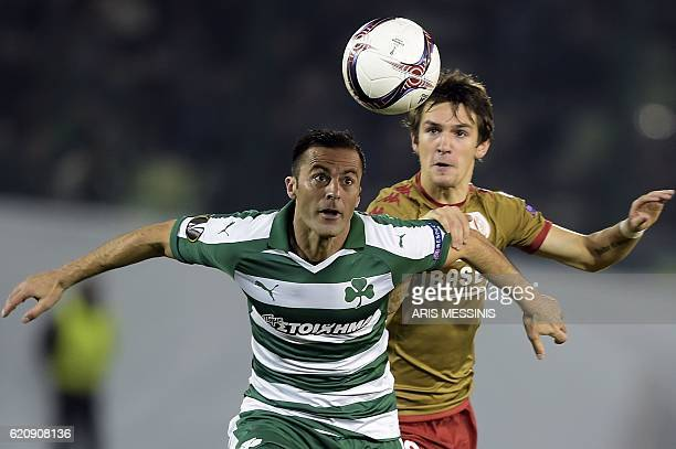 Panathinaikos' Italian defender Giandomenico Mesto fights for the ball with Standard Liege's Belgian forward Benito Raman during the UEFA Europa...