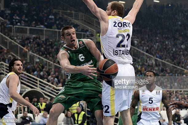 Panathinaikos' Michael Bramos is countered by Luka Zoric of Fenerbahce Ulker during their top16 round 11 Euroleague basketball game at the Athens...