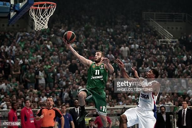 Panathinaikos' Nikos Pappas jumps to score in front of CSKA Moscow's Kyle Hines during the Euroleague playoff basketball match between Panathinaikos...