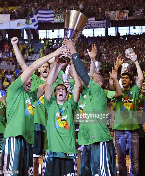 Panathinaikos players holds up the trophy after winning the Turkish Airlines EuroLeague Final Four final match between Panathinaikos and Maccabi Tel...