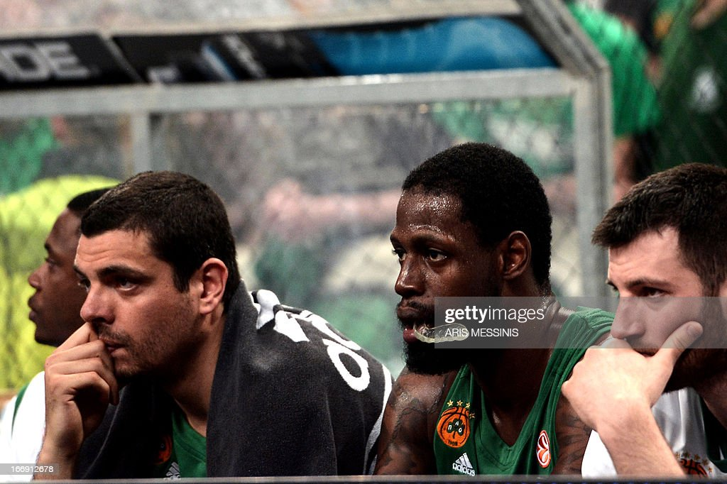 Panathinaikos' players react after their team lost against Barcelona during the Euroleague playoff basketball game Panathinaikos vs Barcelona at the Athens' Olympic Indoor hall on April 18, 2013.