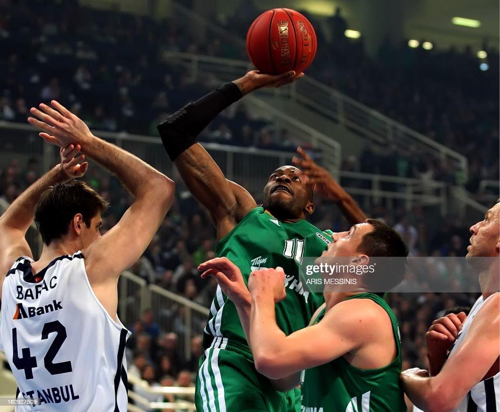 Panathinaikos' Stephane Lasme (C) jumps to score during the Euroleague top 16 basketball game Panathinaikos vs Anadolu Efes in Athens on March 1, 2013.