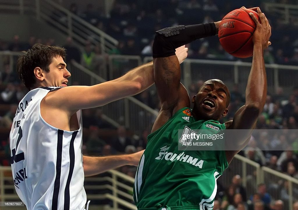 Panathinaikos' Stephane Lasme (R) vies with Anadolu Efes' Stanko Barac during their Euroleague top 16 basketball game Panathinaikos vs Anadolu Efes in Athens on March 1, 2013.