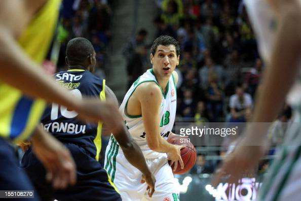 Panathinaikos' Vassilis Xanthopoulos vies with Fenerbahce Ulker's Romain Sato during the Euroleague basketball match Fenerbahce Ulker vs...