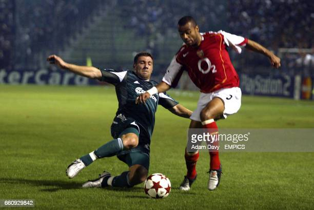 Panathinaikos' Yannis Goumas tackles Arsenal's Ashley Cole