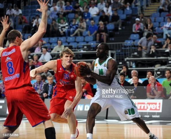 Panathinaikos`s Romain Sato vies with CSKA Moscow`s Andrei Kirilenko and Ramunas Siskauskas during the Euroleague Final four basketball semifinal...