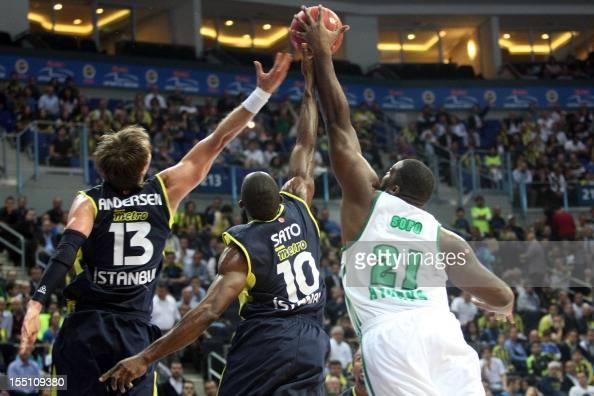 Panathinaikos's Sokoklis Schortsanitis vies with Fenerbahce Ulker's David Andersen and Romain Sato during the Euroleague basketball match Fenerbahce...