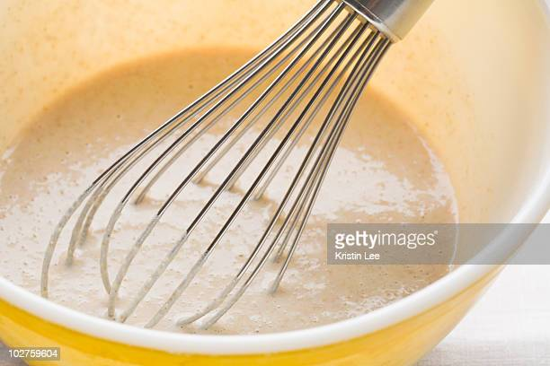 Pancake batter and whisk in mixing bowl