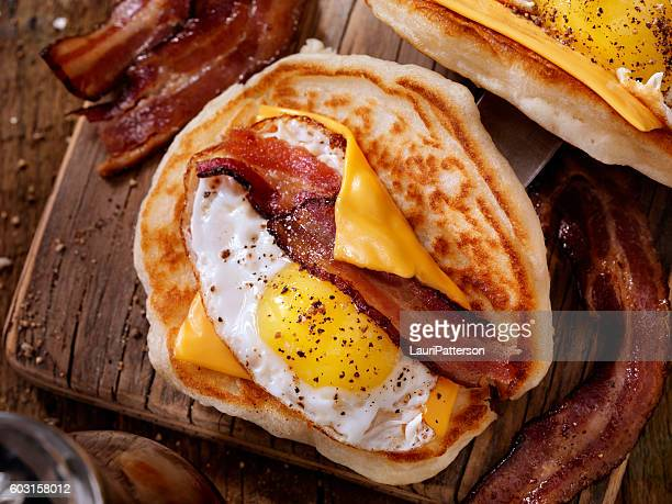 Pancake Breakfast Taco with Suny side up Eggs, Bacon, Cheese