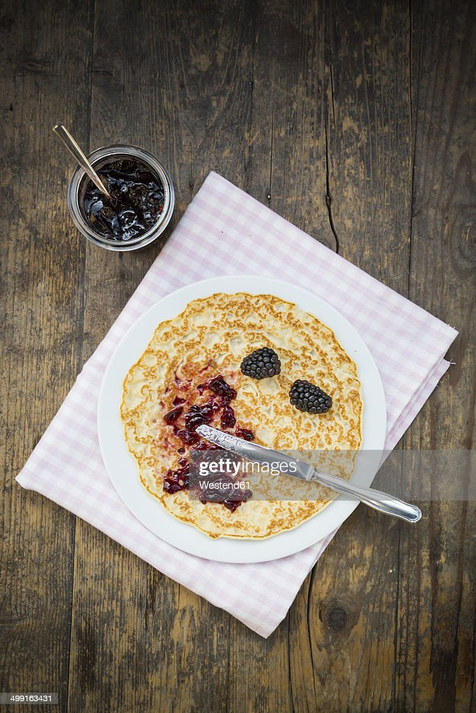 Pancake with blackberry jelly and blackberries