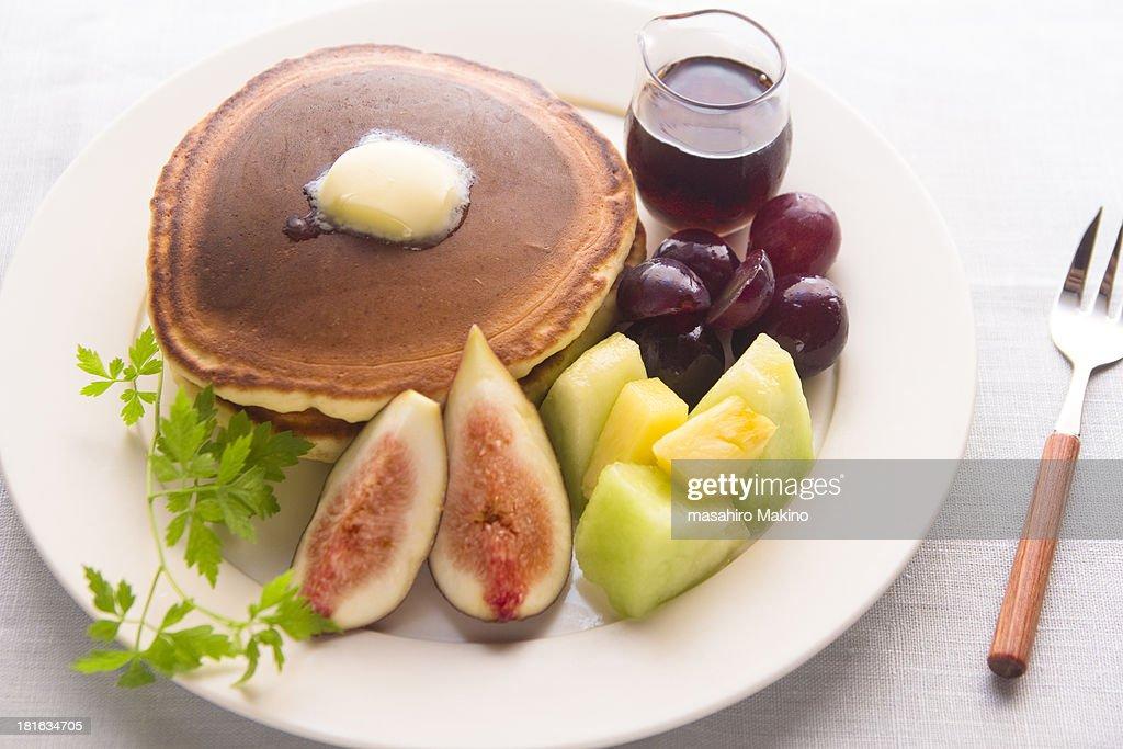 Pancakes and fresh fruits : Stock Photo