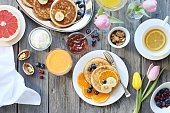 Pancakes. Breakfast set with pancakes, fresh berries, banana and various of topping. Overhead view, selective focus